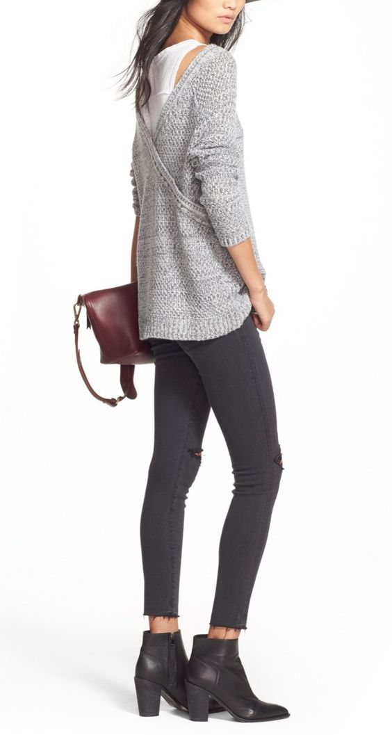Crushing on this richly textured sweater paired with distressed denim and black booties for a casual yet chic look on-the-go.