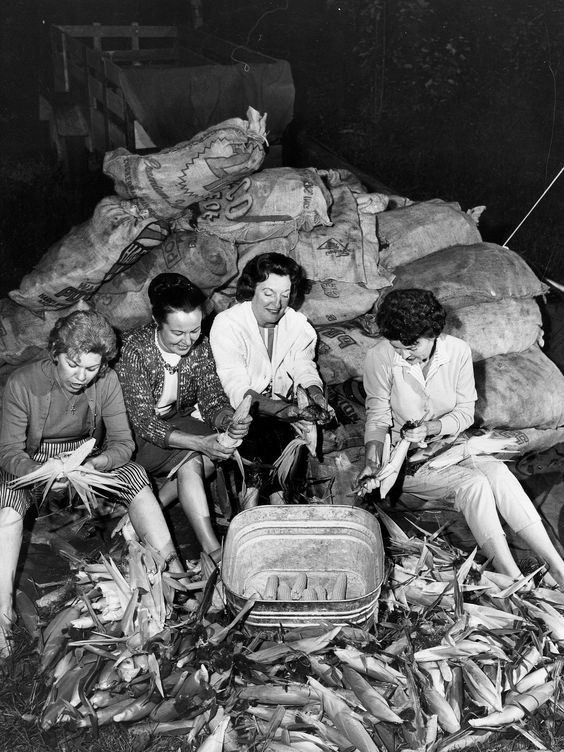 Women shuck corn at a Detroit Police picnic in September, 1963.
