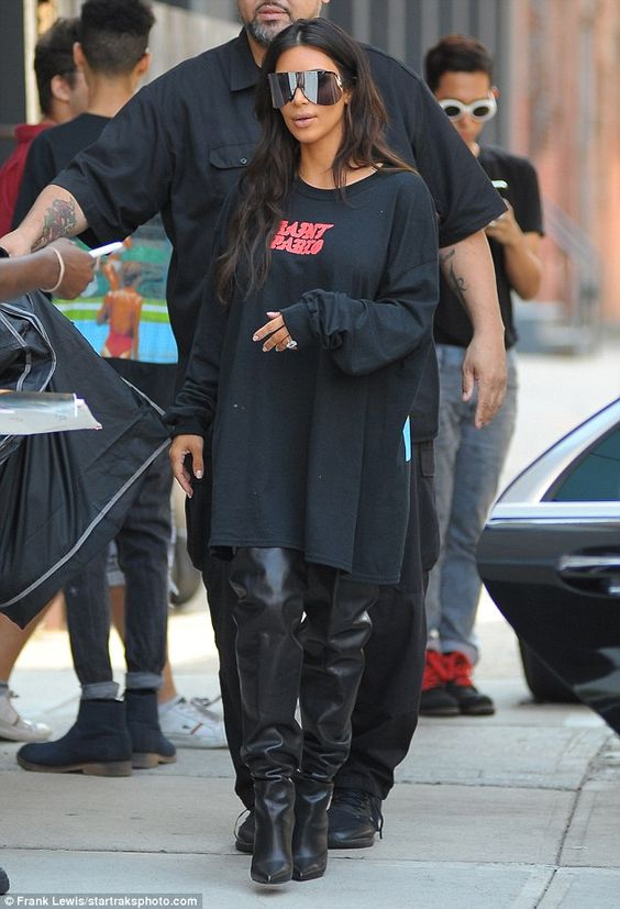 Thigh's the limit! The mother-of-two coupled the loose-fitting Saint Pablo T-shirt with a pair of daring, black leather boots