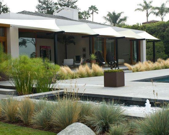winterharte Pflanzen im Garten Stein Terrasse Pool Ziergräser - terrassengestaltung mit wasserbecken