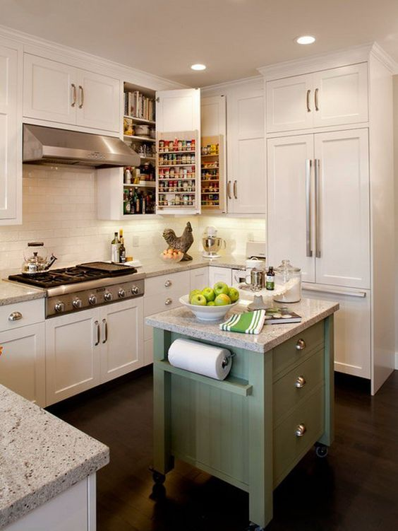 A Flash of Green. What is much clever than this awesome small green island on wheels. It pops the white kitchen. And the spice storage and the layout of fridge by oven are also very great.