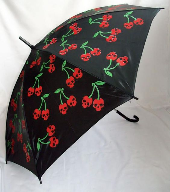 Black umbrella with red skull cherries