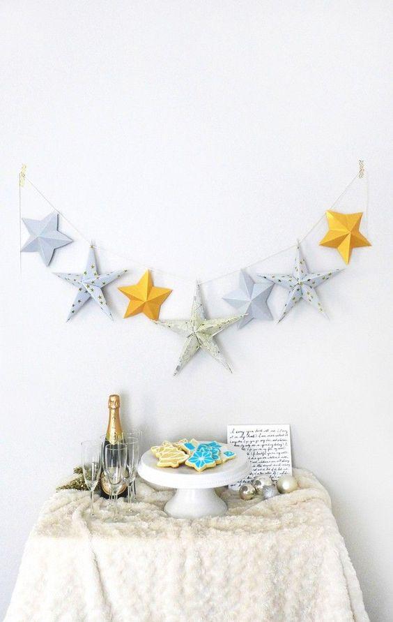 guirlande d'étoiles en 3D jaunes et grises - une idée originale d'origami Noël