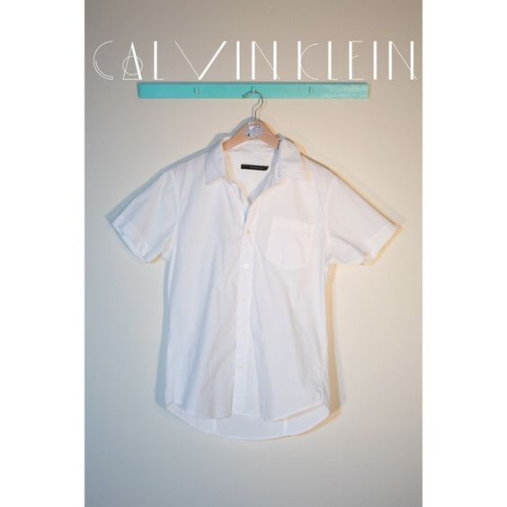 White Calvin Klein Short Sleeve Button Down A comfy white short sleeve button down from Calvin Klein Jeans with label ribbon under buttons. Few very small stains on back. 100% cotton. Size large. Calvin Klein Tops Button Down Shirts