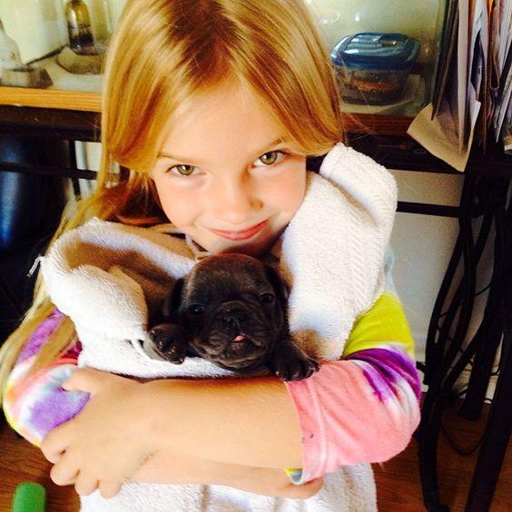 Mia Talerico holding a puppy. miatalerico101 on Instagram
