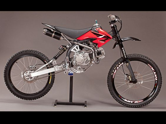 Motoped with 155cc engine and optional foot-peg kit.  Motoped: Motorized Bicycle Motoped - a DIY motorized bike kit that you assemble yourself using a XR50/pitbike engine and standard mountain bike components.
