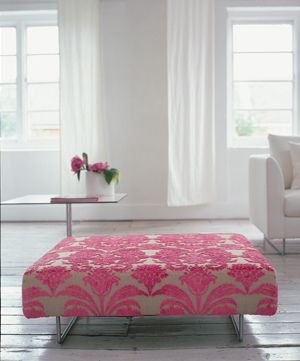 oversized ottoman. pop of color. floors. windows. white. girly.