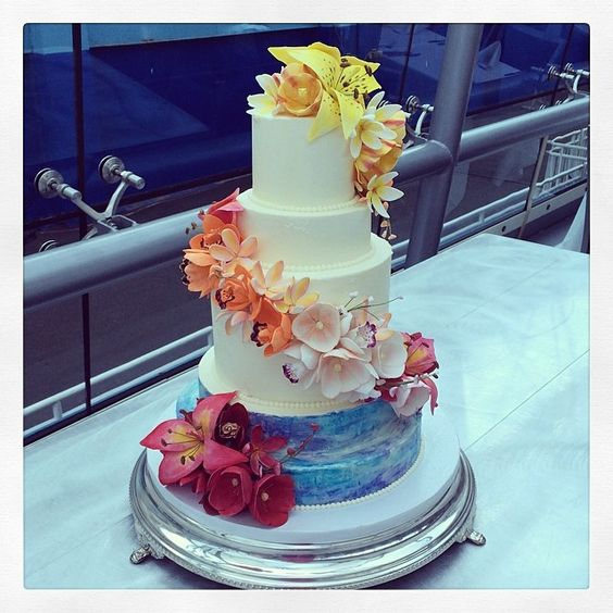 Lots of color and tropical flowers on this wedding cake; perfect for a sunset cruise wedding on The Hudson. Congratulations, Samantha and Lauren!! Photo by Sugar Flower Cake Shop. www.sugarflowercakeshop.com