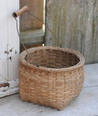 basket with a French twisted wire & wooden handle