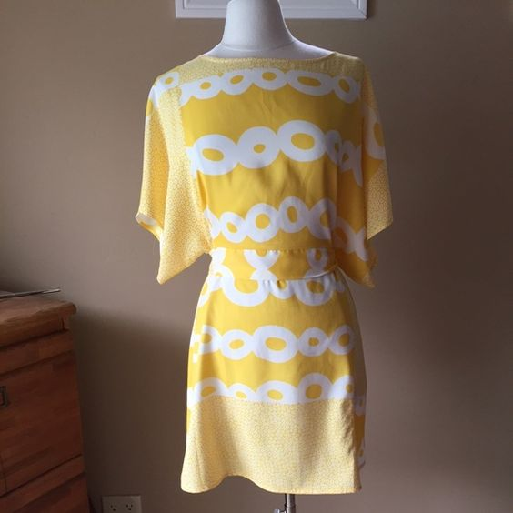 Vertigo Paris Yellow Dress Yellow dress with attached sash and kimono sleeves. Back zipper. Loose fit, so should fit size small-medium. Shown on size 6/8 mannequin (37-26-37)Check out the $6 section near the bottom of my closet (before the sold items) for lots of bundle-worthy $6 items! 15% bundle discount on 2+ items in a bundle.NO TRADES Vertigo Paris Dresses