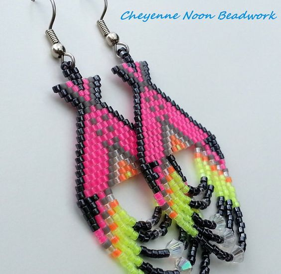 These brick-stitch earrings are made with Delica seed beads in luminous shocking pink and coordinating colors, and hoop fringes featuring faceted
