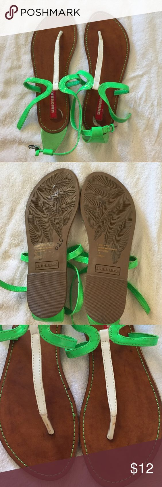 Union bay sandals excellent condition! Perfect for summer! Neon green strap with white makes for cute color blocking! Tagged as new with tags because these have never been worn (see bottom) and still have the sticker! They have some small scuffs at toe potion which is not noticeable if you wear them! (See pic 4) also have removed tag on top of shoe sole so it has some sticky residue since I didn't remove all of it. This can be removed with nail polish remover! Unionbay Shoes