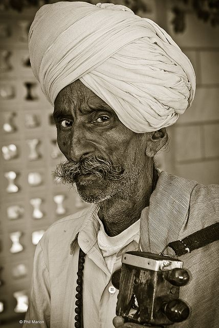 Street busker musician - Agra, India, by Phil Marion