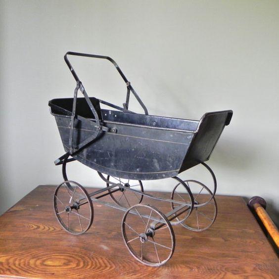 Vintage metal doll buggy stroller photo prop antique black toy planter patio sunroom doll collector. $39.99, via Etsy.