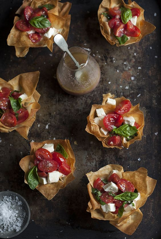 Caprese salad cradled by phyllo cups + olive tapenade vinaigrette -- a classy and savory appetizer, indeed. | drizzleanddip.com