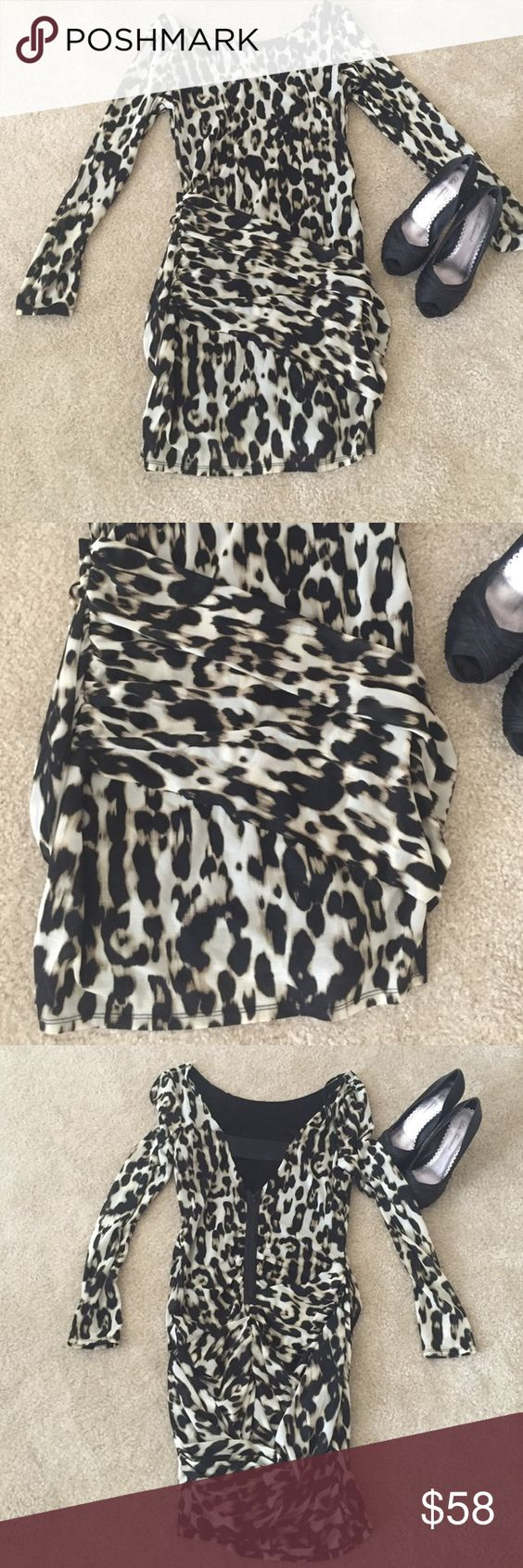 Guess Animal Print Low back Mini Dress! Guess Low Back Animal Print Mini Dress! Super sexy and cute! Low V back with zipper. Bottom of the dress has rouchin. Brand new never worn with tags. Guess Dresses Mini