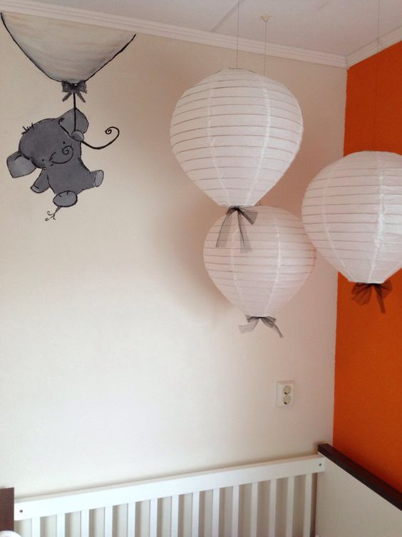 adorable elephant holding onto a balloon. chinese lanterns as hot air balloons... cute