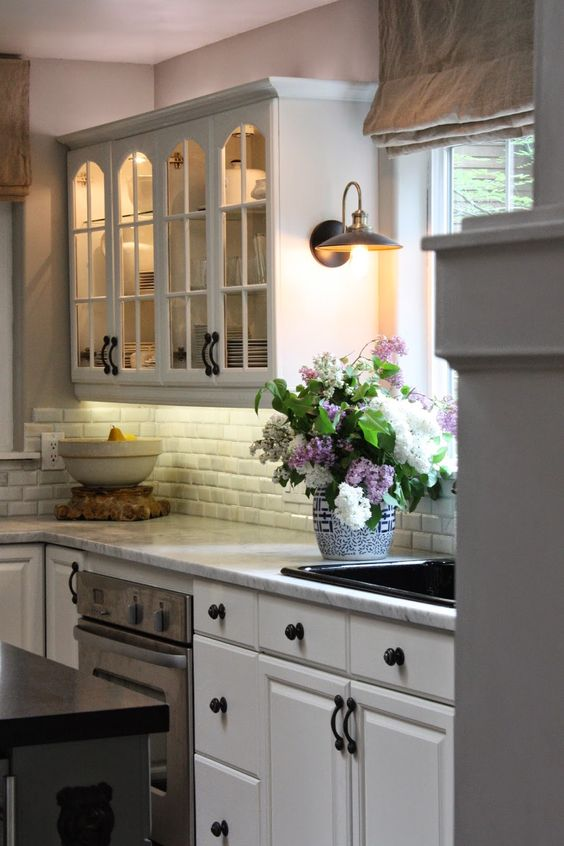 Kitchen; love the sconce over the counter, white cabinets ...