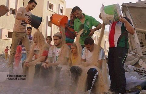 Palestinians launch #RubbleBucketChallenge to create awareness for suffering in #Gaza http://t.co/R8aOFpvbVc