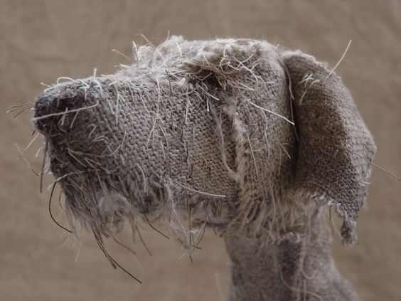 Holy Smoke -- a serious of burlap dogs.   This particular guy looks a bit like our Seamus.