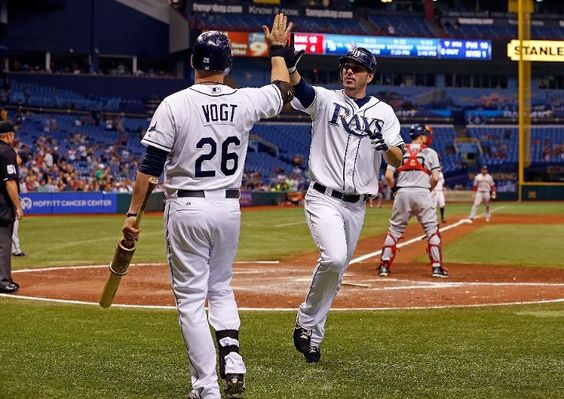 Outfielder Matt Joyce #20 of the Tampa Bay Rays is congratulated by Stephen Vogt #26 after scoring against the Boston Red Sox during the game at Tropicana Field on September 20, 2012 in St. Petersburg, Florida.