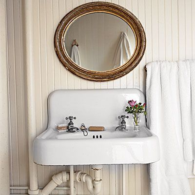Show It Off: Use paint color to highlight antiques. Paint exposed pipes or ducts the same hue as their surroundings to trick the eye and make the utilitarian objects appear less prominent. To focus attention on a single object, such as this antique sink, paint adjacent surfaces a softer, creamier white.