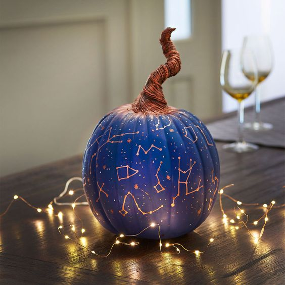 Create an unusual DIY pumpkin that is out of this world, adding paint and constellations: