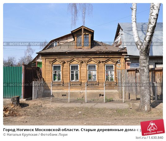 Decorated Izba. Russian village. Carved frames,wooden patterns...