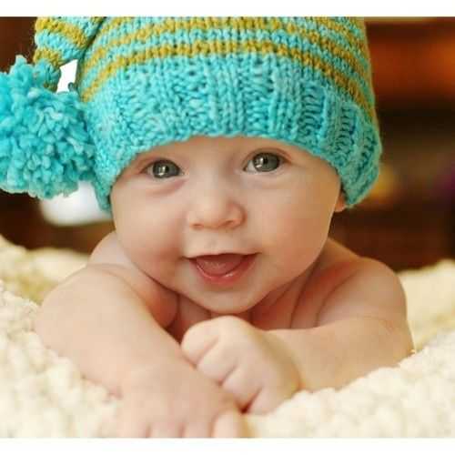 cute baby boy with snow
