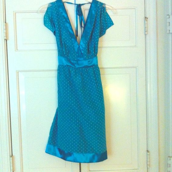 Sexy Guess Dress Turquoise and white polka dot dress. V neck front and back. Tie at back at neck and waist. Split short sleeves. Wore it once on my honeymoon- perfect summer date dress! Guess Dresses