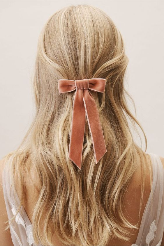 Sweet pink velvet hair bow for a wintery touch | Junebug Weddings