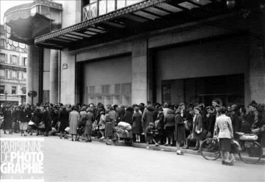 October 1943 - Line in front of the department store Le Bon Marche to exchange old rags for textile points redeemable for new clothing. Copyright LAPI/Roger-Viollet