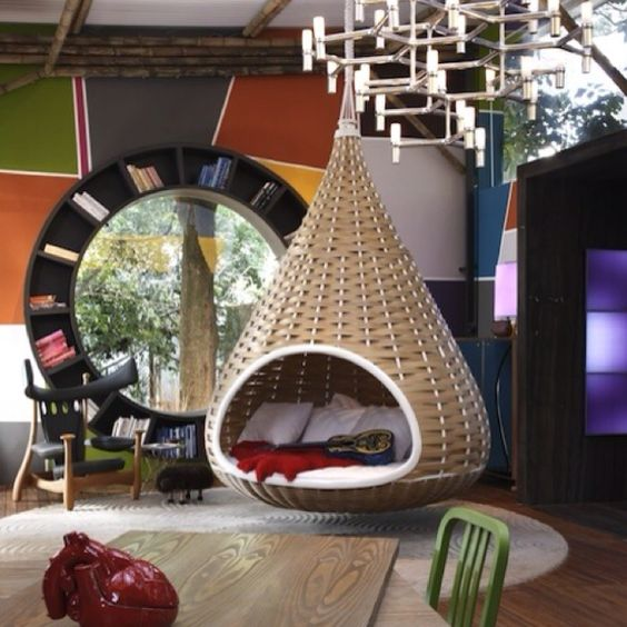 This has got to be the coziest looking lounge area I've seen. Im diggin' the wicker basket nest chair