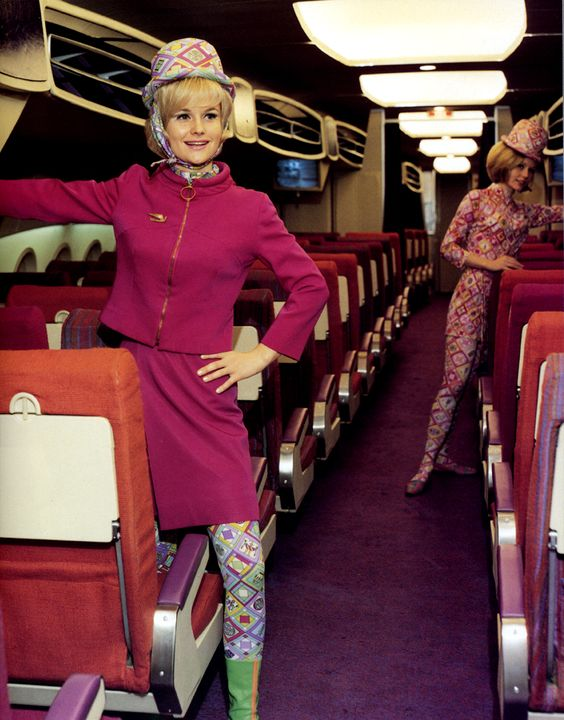 """In 1964 when insurance mogul Troy Post bought ailing Braniff Airlines he gave the company a major make over. His """"The End of the Plain Plane"""" campaign included hiring architect Alexander Girard for the design of the planes and Italian fashion designer Emilio Pucci to design the staff uniforms. Post also employed a fleet of """"jelly bean"""" colored jets. Continue reading for more pictures of the retro air glam and videos of advertisements starring Andy Warhol."""