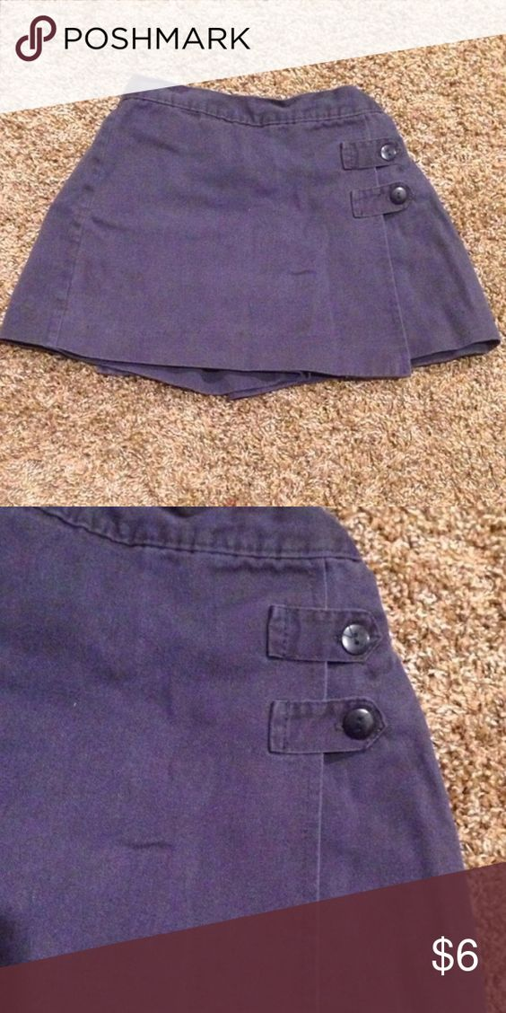 Blue girls uniform skirt with shorts underneath Girls School uniform skirt with shorts underneath made by Dennis uniform. Size 4. Elastic waist. Some fading noted. Otherwise in great shape and should last your child for a long time. Dennis Uniform Bottoms Skirts