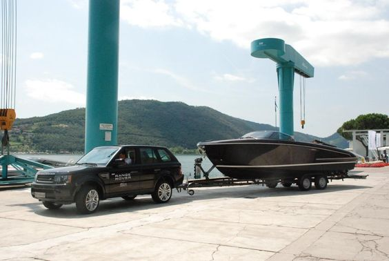 Land Rover pulling a  Riva in Italy. Can't get much better then that. Except to be in the boat on Lago Iseo. (been there.)