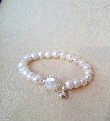 Perlas cultivadas y plata de ley, diseño de Ala de Plata