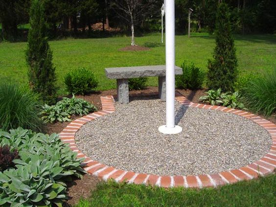 raised beds, stone bench and house on, flagpole landscaping ideas