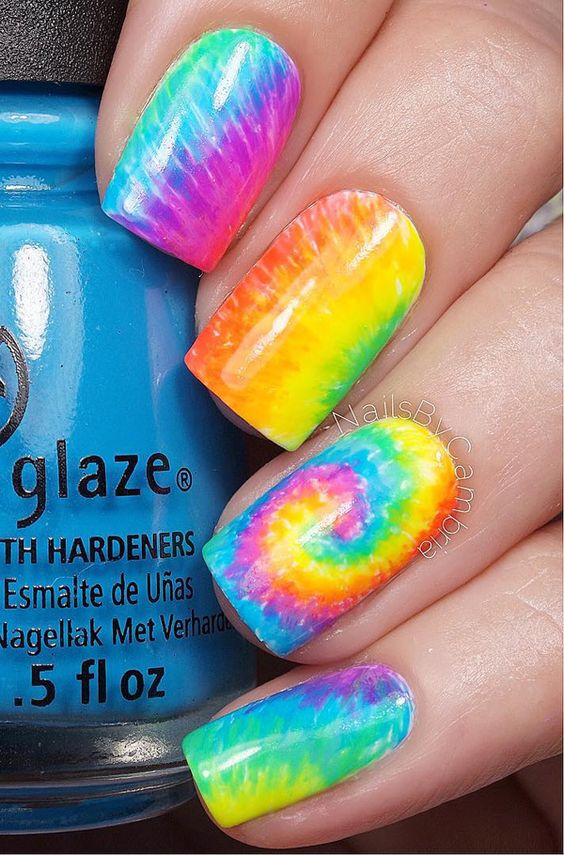 A tie dye inspired watercolor nail art. Create various tie dye designs using watercolor style. The brighter the colors, the better and the more colors you combine the more interesting the combination looks.