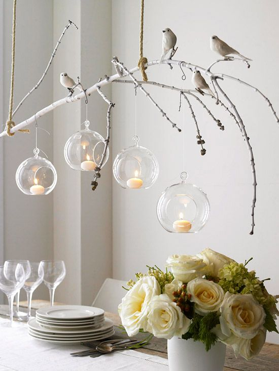 stunning chandelier, which was crafted on a shoestring. Spray-paint a bare branch white. When dry, make it a perch for clip-on songbirds (available at crafts stores). Place removable adhesive hooks on the ceiling, then hang the branch above your table using two ropes. Tie hanging tea-lights or votive holders from the branch using fishing line. Light the hanging votives and watch the nature-inspired chandelier sparkle sans crystals.: