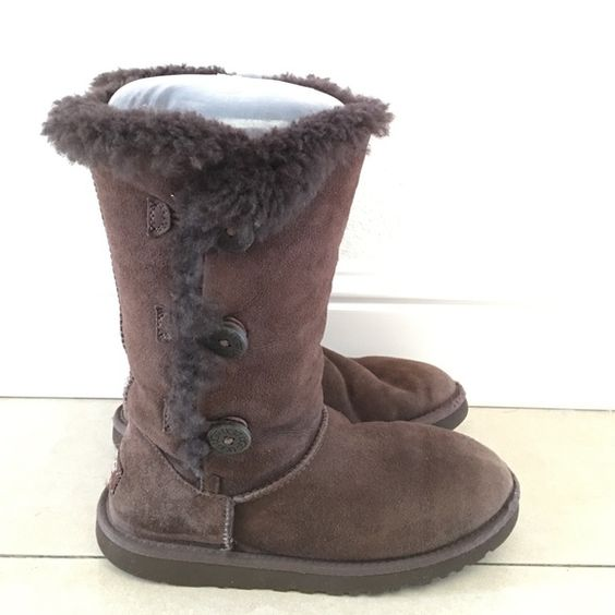 Authentic UGG Brown boots 3 buttons Size 6 Preowned and in good condition Authentic UGG brown boots 3 buttons Size 6. They have authenticity holographic tag. They have normal wear, no tears or holes. All buttons are working. Please look at pictures and read description so you know what you are purchasing  UGG Shoes Winter & Rain Boots