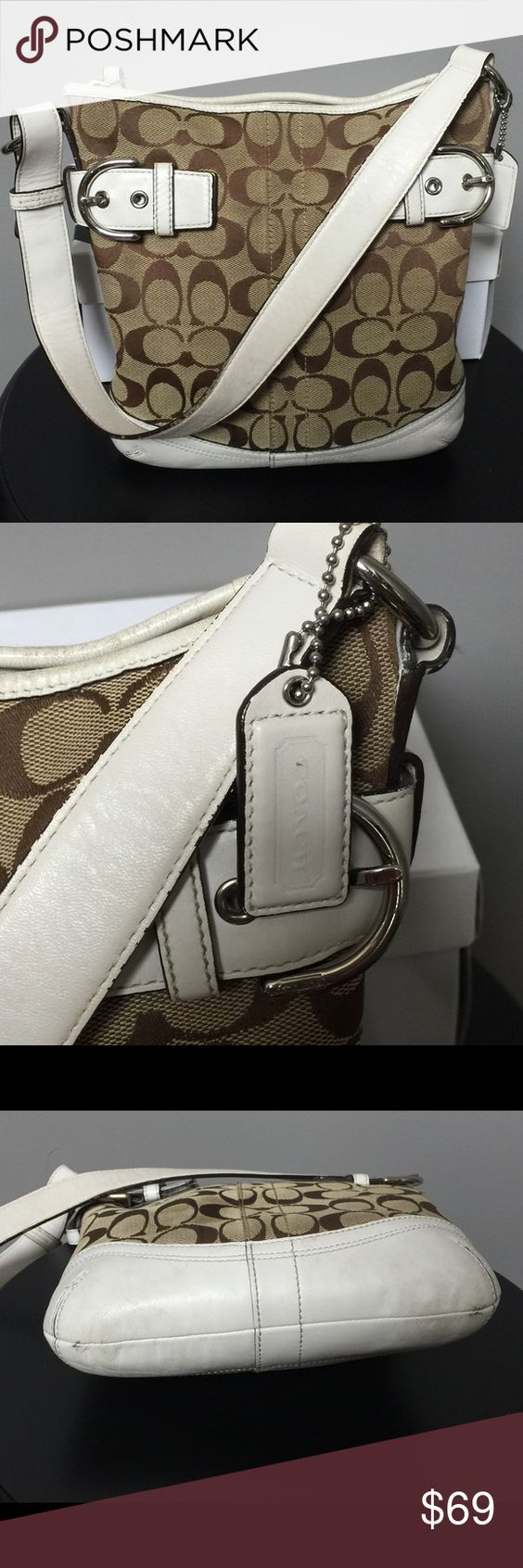 Coach white signature logo duffle bag White leather trimmed coach handbag. Some wear on leather (shown in picture). Coach Bags Shoulder Bags