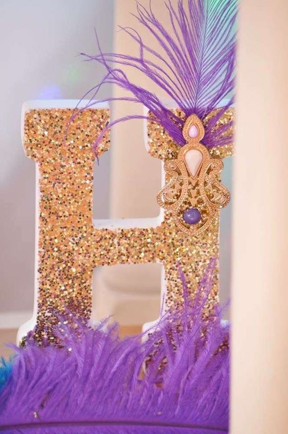 Glitter letter at a Princess Jasmine birthday party! See more party planning ideas at CatchMyParty.com!: