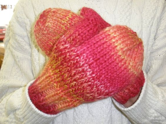 Mittens are made with a bulky yarn and are by coxysknittedstuff, $35.00