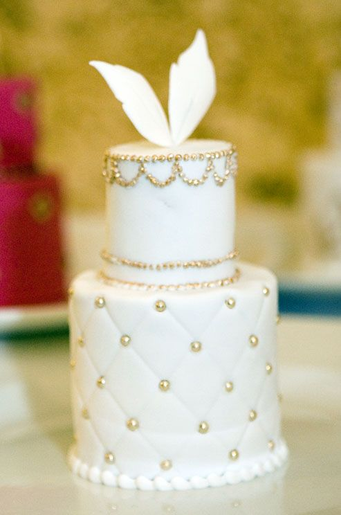 White Fondant Feathers And Gold Dragees Top This Quilted Individual Wedding Cake