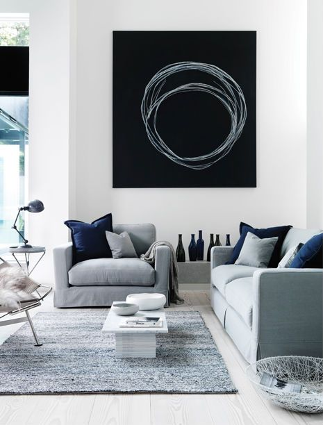Grey, black, white and blue.  I would warm it up with some wood, bronze, gold, copper accents