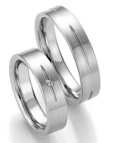 Trauringe Denton  Edelstahlringe  Damenring mit 1 Diamanten, 0,02 ct,  Ringbreite: 5,0 mm,  Stärke: ca. 1,8 mm,  Oberfläche: strichmattiert