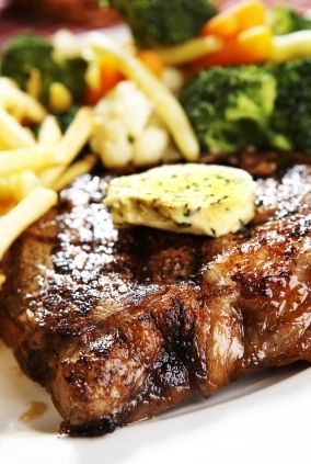 Steakhouse steaks with herb butter...I would grill this out for summer home baseball games watched outdoors...