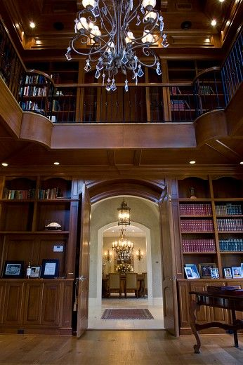 Two story paneled study library with loft spiral for Two story spiral staircase