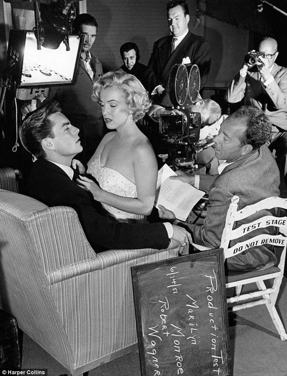 Robert Wagner with a seductive Marilyn Monroe on his lap during a test scene for Let's Make It Legal on June 14, 1951.: